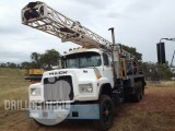 Drill Rig Package: GD1000 Drill Rig  on a Mack, Support Truck, Compressor  Truck, Compressor, Rod sloop, Skid  mounted pump